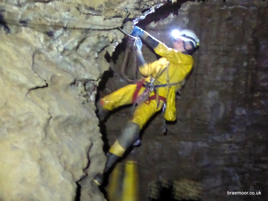 Negotiating the traverse above Puits de l'Oubliette in Grotte Chevalier